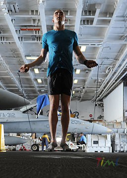 US_Navy_101004-N-6427M-149_Airman_David_Hall,_from_Buffalo,_N.Y.,_jumps_rope_during_a_training_session_in_the_hangar_bay_aboard_the_aircraft_carrie